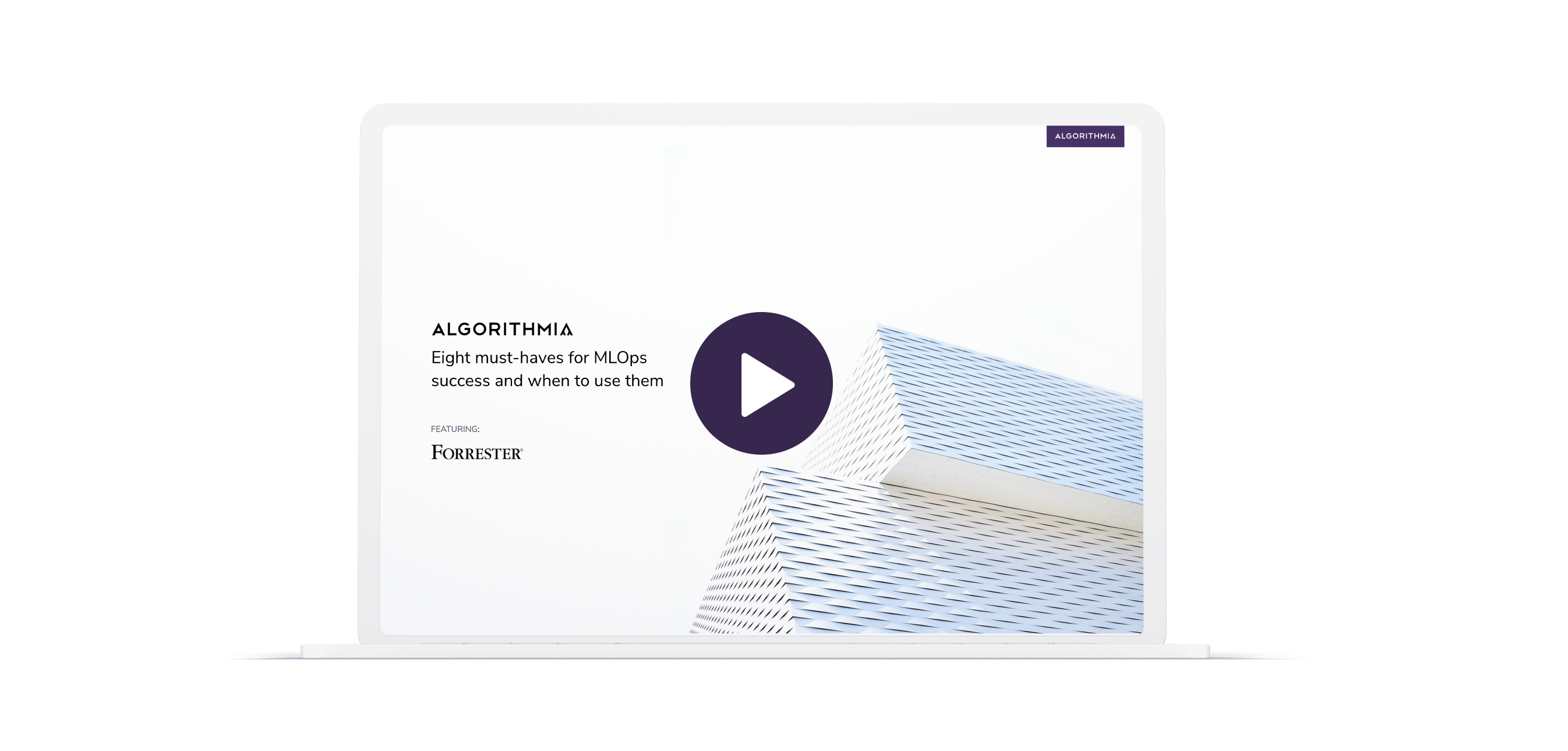 A laptop is open to show the opening title slide of the Algorithmia and Forrester webinar. A purple play button is over the slide.